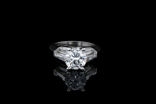 Round Center Solitaire Tapered Baguette Ring
