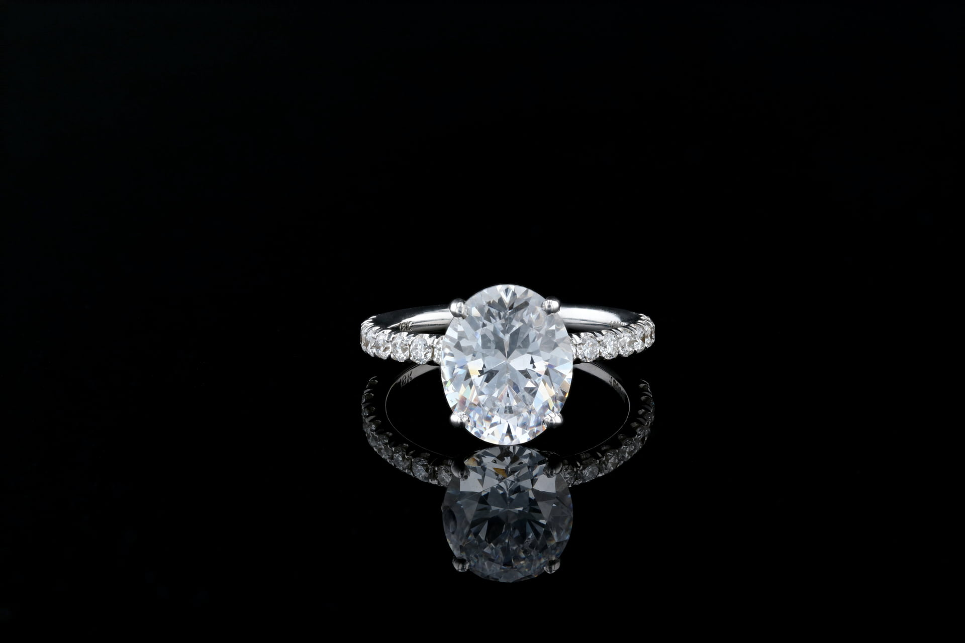 Basket Setting Solitaire Oval Diamond Ring Nathan Alan Jewelers