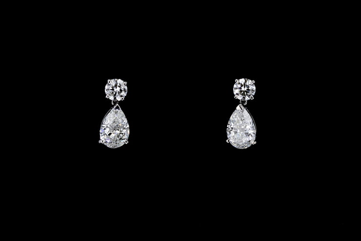 Pear and Round Dangling Diamond Earrings